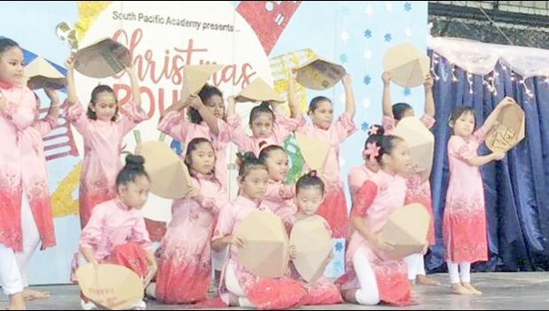 South Pacific Academy students performing in their Christmas program