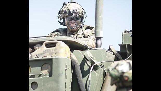 Staff Sgt. Sapa Taala on a tank.