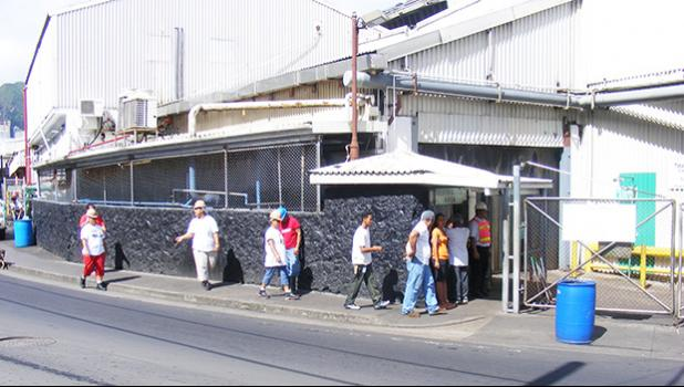 StarKist workers enter the canning plant in Pago Pago, American Samoa.