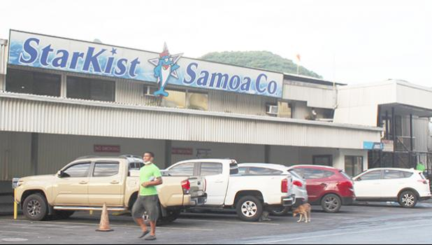 Man walking by StarKist Samoa canning plant