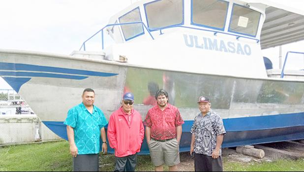 """This photo, taken last month in Apia, Samoa and provided over the weekend to Samoa News by ASG Commerce Department, shows [l-r] Youth and Women's Affairs Deputy Director Pa'u Roy Ausage, Gov. Lolo Matalasi Moliga, Samoa government fisheries official Ueta Fa'asili Jr, and the Governor's chief of staff Fiu J. Saelua in front of the """"super alia"""" vessel named, Ulimasao, which belongs to the Samoa government Ministry of Agriculture and Fisheries.  [photo: provided DOC]"""