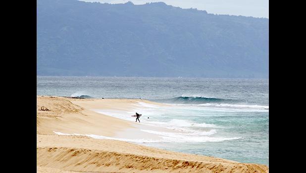A surfer at Haleiwa HA