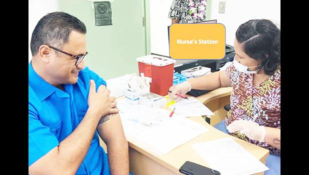 Lt. Gov. Talauega Eleasalo Va'alele Ale (left) preparing to receive his Moderna COVID-19 vaccine