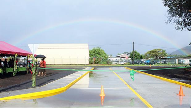 Rainbow over the Tasi Street Extension dedication ribbon