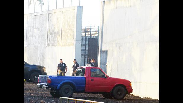 TCF guards changing shifts outside wall
