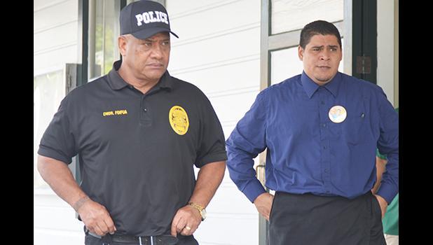 Thomas Siaumau escorted by Chief of Police Cmdr. Foifua Foifua