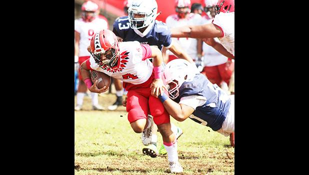 A Samoana defender brings down the Vikings ball carrier