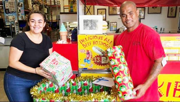"Tiara Drabble (left) received two gifts from a Cost-U-Less employee for the Le Taupou Manaia Dance Academy ""Toys & Joy Drive for Samoa"" this past Dec. 2019"