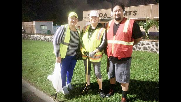 (L-R) Mrs. Tuu Vai (far left), her sister Mrs. Lise Tauiliili (middle) and American Samoa Power Authority engineer Andre Milford