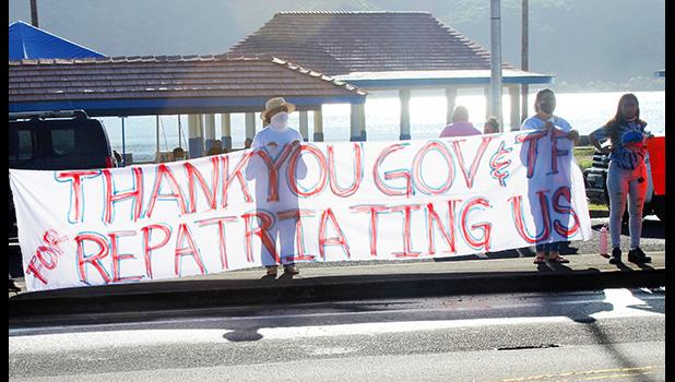 TTFAAS members with thank you banner waving to drivers passing by