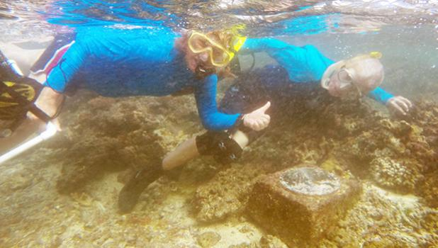 Dr. Charles Birkeland and Dr. Alison Green at the Aua Transect underwater marker. The Aua Village Transect project — the oldest survey of a coral reef in the world — celebrated its 100th anniversary last week. [photo: courtesy]