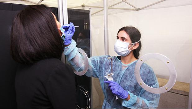 GoHealth Urgent Care staff testing a United Airlines crewmember.