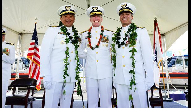 Capt. Arex Avanni (left),Capt. Michael Long (right),Rear Adm. Kevin Lunday (center)