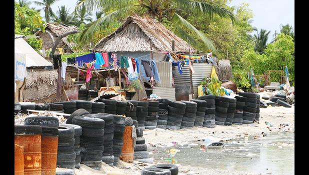 Village with tires protecting coastline from rising ocean tides