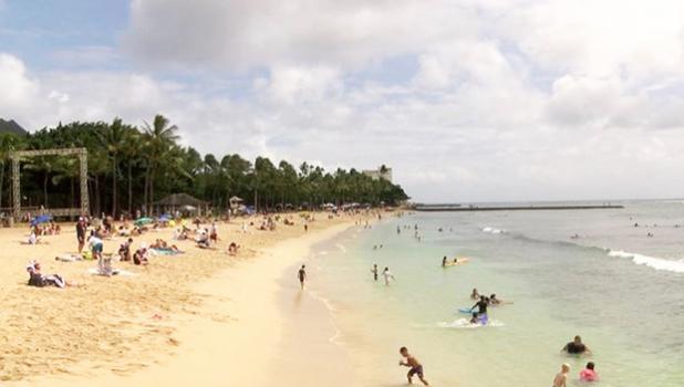 Waikiki Beach with sun bathers and swimmers