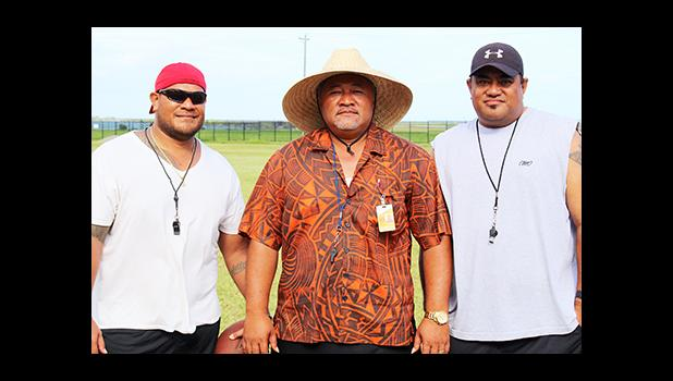 The Head Coach of the Nu'uuli Wildcats Football Program, NVTHS Principal Tupa'i Rod Atafua (center) posing for a coach's photo with his assistant coaches Bill Ena (right) and Sene Ilileli (left) – not pictured are Christian, Viliamu, Pualau and Robert. [photo: TG]
