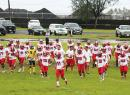 Faga'itua Vikings Football Team running towards the sidelines