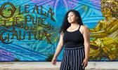 Leah McKenzie, of Long Beach standing before the mural.
