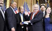 In this Jan. 5, 2011 file photo, House Speaker John Boehner, second left, of Ohio participates in a ceremonial House swearing-in ceremony for Del. Eni H. Faleomavaega, third from right, D-American Samoa, on Capitol Hill in Washington. American Samoa's longest serving non-voting delegate to the U.S House of Representatives Faleomavaega died Wednesday, Feb. 22, 2017, at age 73. [AP Photo/Susan Walsh, File]