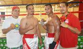 Two professional fighters from American Samoa — Paofe Seeti (second from left) and Ofisa Talaimalo (third from left) with their coach and trainer, Sala Sanele Etuale (left). [photo by AF]