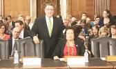 Congresswoman Aumua Amata with Assistant Secretary Doug Domenech prior to the confirmation hearing in July.  [courtesy photo]
