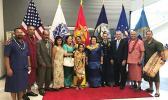 From L-R: Paulo Momoisea from Amaluia, SFC (USA Ret.) Robert Tua from Aasu, CSM (USA Ret.) and Mrs. Ioakimo Falaniko from Utulei, Mrs. Robert Tua, Vasa Loa and daughter Marilyn from Asili, Rep. Aumua Amata, CSM Charles M. Tobin, Acting DOI Assistant Secretary Nikolao Pula, SFC (USA Ret.) Fa'aaliga Matagi from Ta'u, 1SG Junior Galoia  [Courtesy photo]