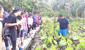 Boat captain for the NMSAS research vessel - RV Manuma - Peter Taliva'a making a brief presentation on the traditional way to maintain a healthy taufusi (taro plantation).  [Courtesy photo]