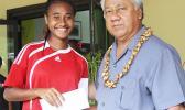 Elcy Lui, left, of Vaiala Tongan's 13-15 girls team receives her MVP award for the 2017 FFAS Summer Youth League from Sen. Faiivae Iuli Alex Godinet on July 15 at Pago Park Soccer Stadium.[FFAS MEDIA/Brian Vitolio]