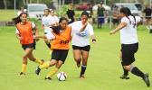 A Fa'asao-Marist Cougars player tries to dribble away from a Samoana Sharks defender in an ASHSAA Girls Soccer J-V game on Saturday, Jan. 21, 2017 at Pago Park Soccer Stadium in Pago Pago.  [FFAS MEDIA/Brian Vitolio]