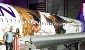 """Hawaiian Airlines revealed last Saturday the first of three """"Moana"""" themed planes at its home base at Honolulu International Airport.  Pictured on the stairs are Auli'i Cravalho, the Hawaiʻi-born actress who is the voice of Disney's """"Moana,"""" and Dwayne 'The Rock' Johnson, the voice of demigod Maui, and were among the first to see the new design. [Photo: Donald Traill for Hawaiian Air]"""