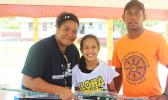 NMSAS education and outreach coordinator Isabel Gaoteote presents a fishing rod to one of the winners of this year's Tautai Fagota Fishing Derby in Vaitogi. See story for full details.  [photo: BC]