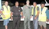 Texan aviator and pilot Brian Lloyd (middle) on the tarmac at the Pago Pago International Airport, with people who serviced his plane last Saturday night, upon arrival for a stopover in American Samoa, around 9 p.m. Lloyd is on an around-the-world solo flight to commemorate American female aviator, Amelia Earhart's famous flight 80-years ago. Pictured with him (L-R) Jason Pritchard of Pritchard's Airport Service — a local airport ground handling company — an airport police officer, and the PAS crew. [photo: