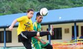 Gabriel Taumua, left, of PagoYouth defends against Utulei Youth's Ne'emia Kaleopa during the men's Cup match of the 2016 FFAS National League's Match Day 4 on Saturday, Sept. 10, at Pago Park Soccer Stadium.  [FFAS MEDIA/Rupeni Luvu]