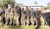 """The leadership and command team of the Headquarters Company (HHC) of the 87th CSSB, of the 3rd Sustainment Brigade, Fort Stewart, Georgia (L-R): SSG POSER, J. SFC SORIANO, M. CPT NORTHRUP, R (Company Commander) SPC AUVA'A, A, SSG BAILEY J, SGT JONES M. SFC SOUTHWORTH T 1LT LOVINGGOOD J. 1LT PASCETTA N (COMPANY EXECUTIVE OFFICER) SPC MCGRAW B. SPC MENDIOLA G. AND 1SG SMITH, as they congratulate SPC Auva'a on achieving her """"gender marker"""" change.  SPC Auva'a is the First Samoan Transgender to serve openly as"""