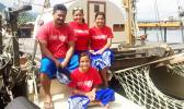 Xavier Lui with his three daughters Nafanua (middle), Leilani (right) and Emma (seated). [photo: Iona Salter]