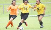 Two Pago Youth defenders (right) in action against an Utulei Youth during a women's game on Match Day 5 of the 2016 FFAS National League on Saturday, Sept. 17, at Pago Park Soccer Stadium. [FFAS MEDIA/Brian Vitolio]