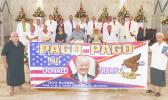 "Sen. Tuaolo Manaia Fruean (left) holding the ""Pago Pago for Trump"" banner with Pulu Ae Ae Jr, while Paramount Chief Mauga T. Asuega, his wife and village traditional and church leaders (on stage)"