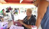 sewing instructor, Diana Tarrant teaching certain methods of sewing to a participant