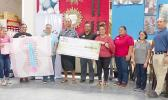 American Samoa Community Cancer Coalition board chairman, Taotasi Archie Soliai  accepts donation from Neil's Ace Home Center