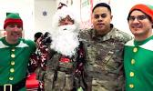 Senior Airman Oto with Santa and his elves