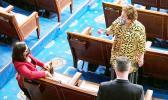 Congresswoman Uifa'atali Amata speaking with an unidentified woman