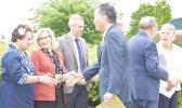 Chairman Takano greeting Congresswoman Amata and Conference Chair Liz Cheney.