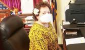 Amata in her DC office wearing a facemask