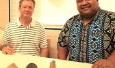Earl Andersen (left) and Territorial Librarian, Justin Maga pictured yesterday at the Feleti Barstow Public Library where Andersen, on behalf of the Rev. Fred Andersen family, returned to the territory what appear to be stone artifacts