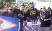 Tanu (Utulei), Charles (Manu'a/Ili'ili), Tau (Manu'a/Atu'u), and Duffy (Manu'a/Petesa) with the American Samoa flag