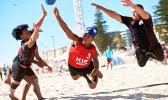 Two members (left and right in black) of the American Samoa National Men's Beach Handball Team