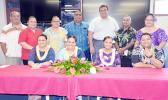 The 4 graduates (seated) and Scholarship Board chairman, Sen. Fai'ivae Godinet and co-chair Donna Gurr recognized the four students and their parents (standing)