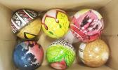 Six of the 26 ornaments painted by Leone HS art students this