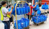 Bags of donations being wheeled to truck for delivery to quarantine center in Honolulu.