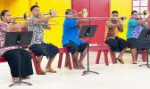 5 young trombone players